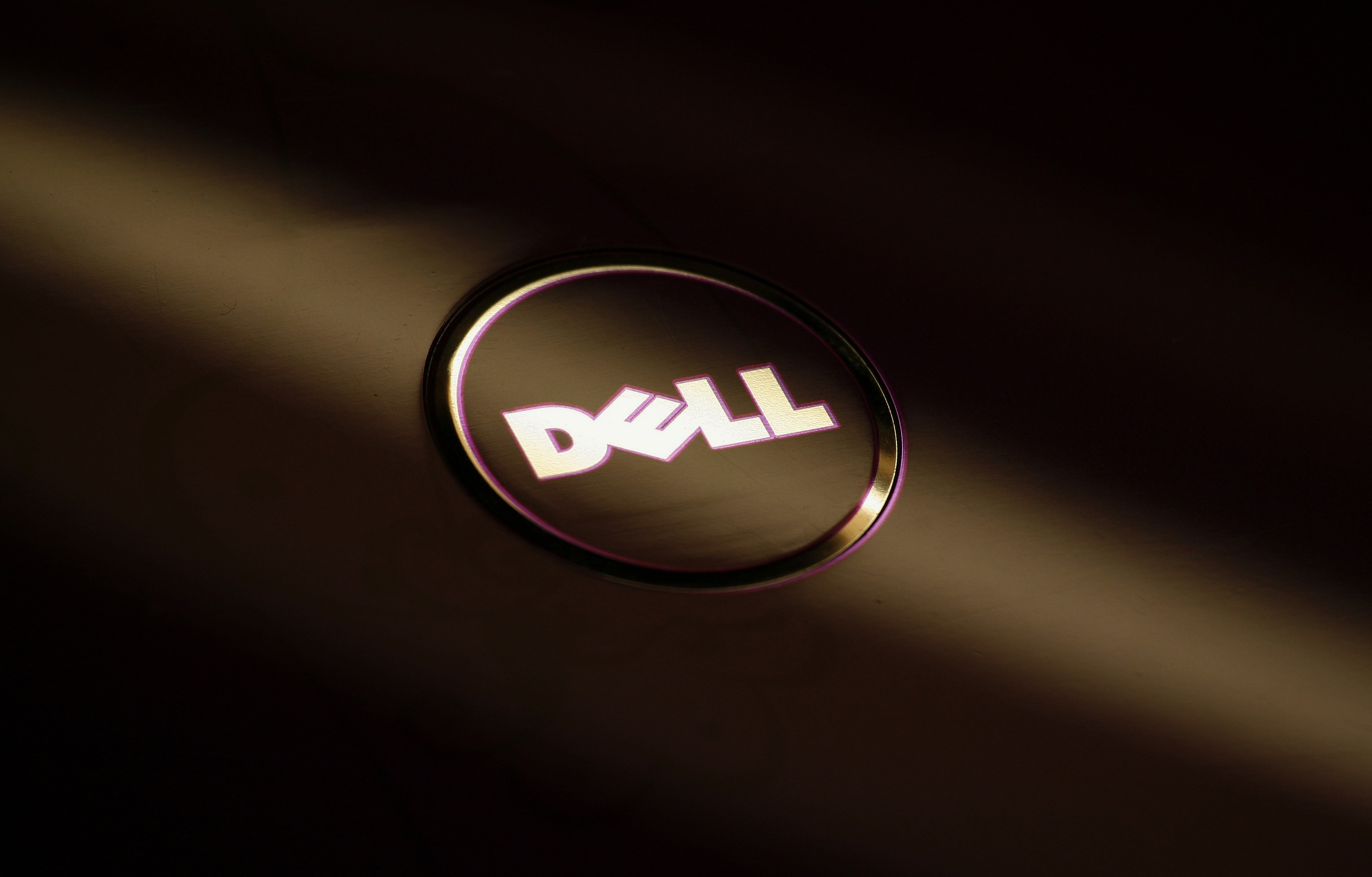 File photo of a company logo of Dell on the cover of its laptop at a Dell outlet in Hong Kong